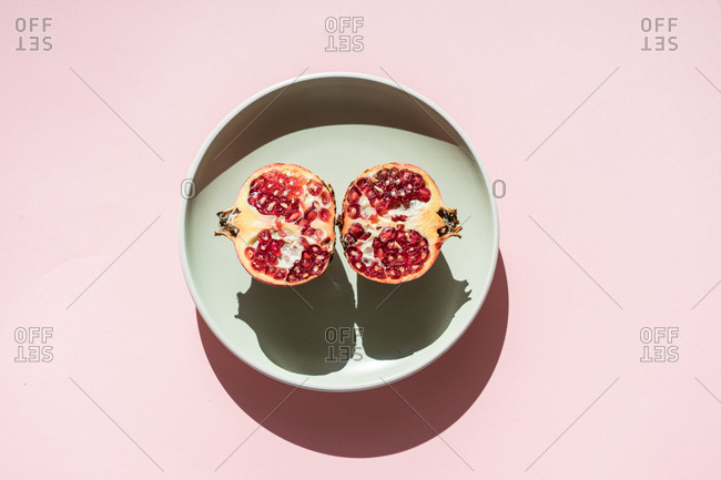 Halves of pomegranate in sunlight