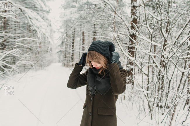 Cheerful woman in winter forest