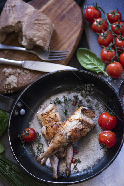 Poultry served on frying pan