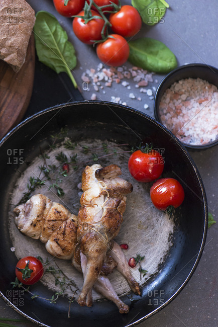 Fried poultry on pan