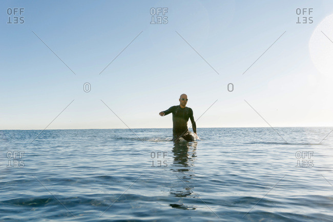 Diver walking into water
