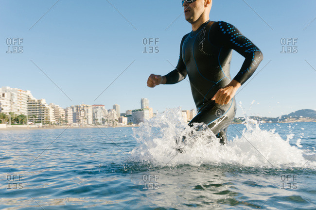 Diver running into water