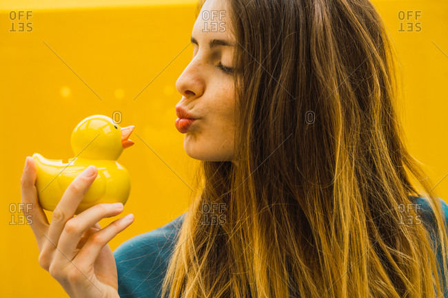 Charming woman with rubber duck