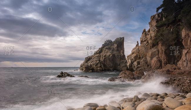 Solitary round Rocks Beach on a winter evening. Beach located in the Mediterranean
