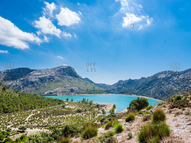 View to big blue lake in mountains in summer sunny day.