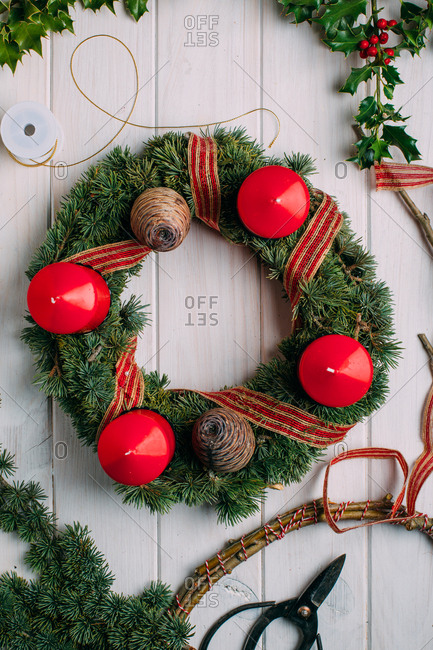 Advent wreath on white wooden background