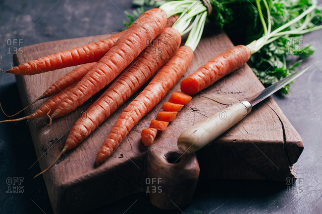 Fresh carrots in a wooden cutting board