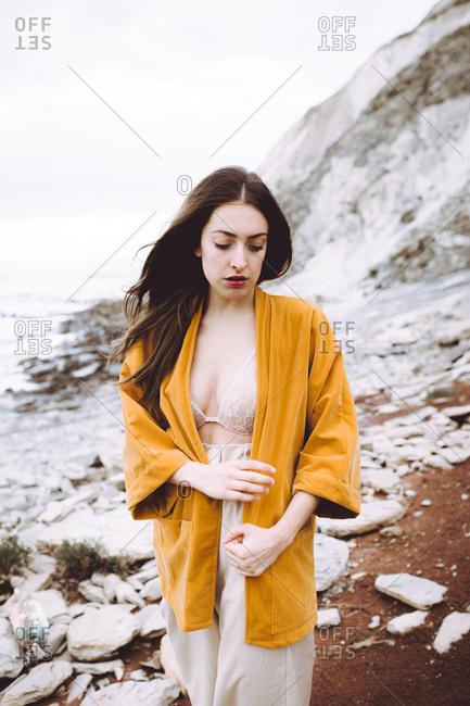 Wonderful gentle model in jacket on shore