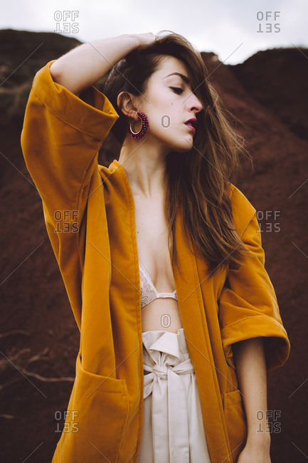 Wonderful gentle model in jacket on shore