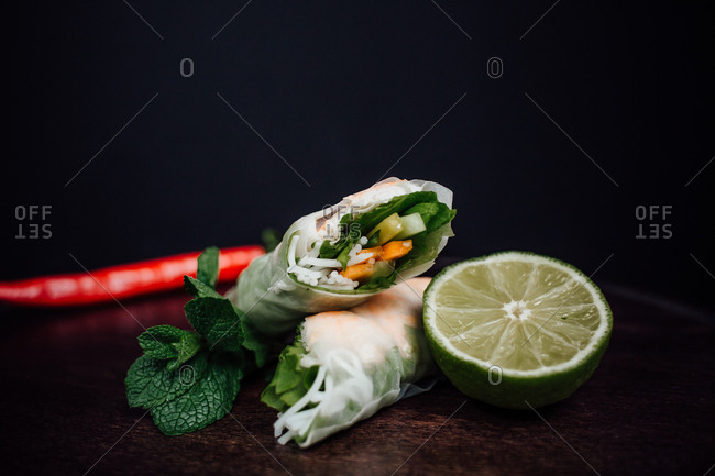 Freshly made Vietnamese spring roll served with lime, mint, and chili pepper