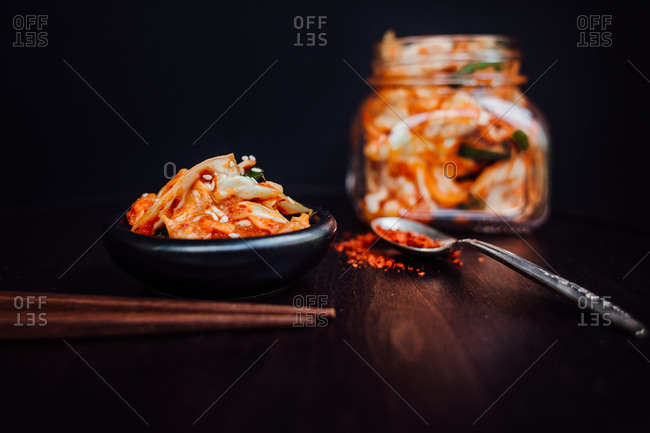 Bowl of kimchi served with chopsticks
