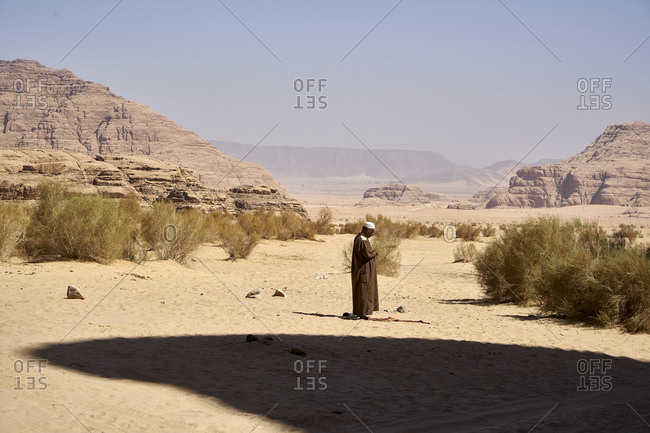 Wadi Rum Desert, Jordan - October 22, 2017: Zalabia Bedouin praying in Wadi Rum (The Valley of the Moon), a protected desert wilderness