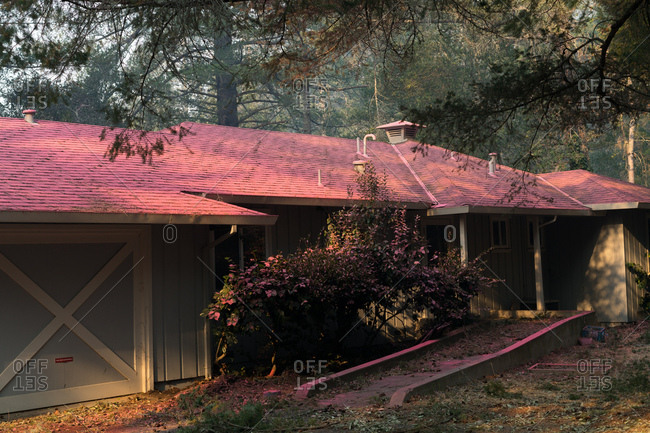 Fire retardant to protect against wildfires giving a house a surreal look