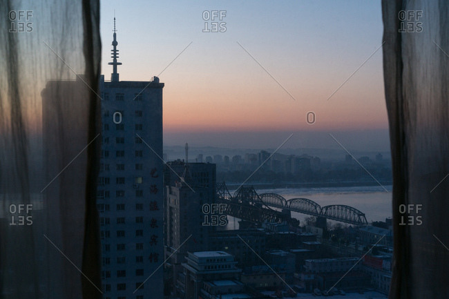 Dandong, China - December 15, 2017: View of the Sino Korean Friendship Bridge spanning Yalu River at dawn
