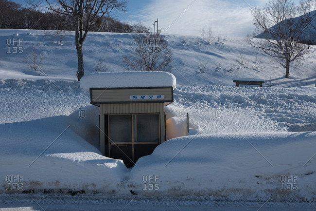 Akita, Japan - January 07, 2018: Bus stop almost buried by deep snow