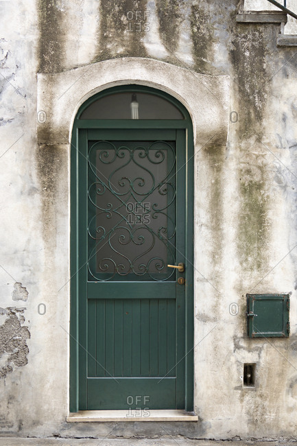 Green door on building in Capri, Italy