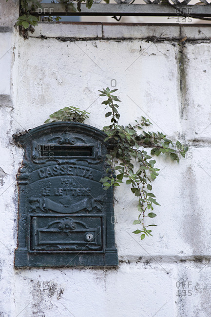 Mail slot on stone wall in Capri, Italy