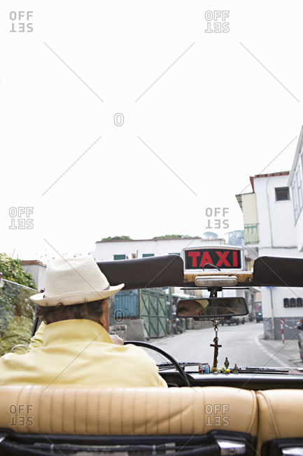 Rear view of man driving a taxicab in Capri, Italy