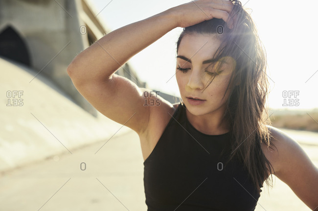 Young woman catching breath after exercise