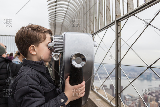 Boy on observation platform looking over New York City
