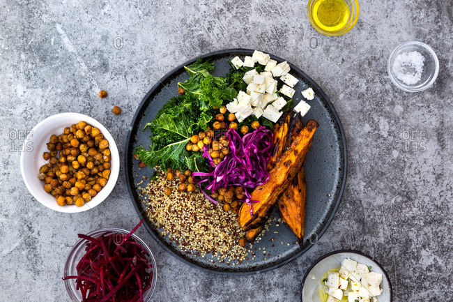 Kale, quinoa, roast sweet potato wedges, red cabbage, beetroot, chickpeas and feta cheese served as part of vegetarian bowl