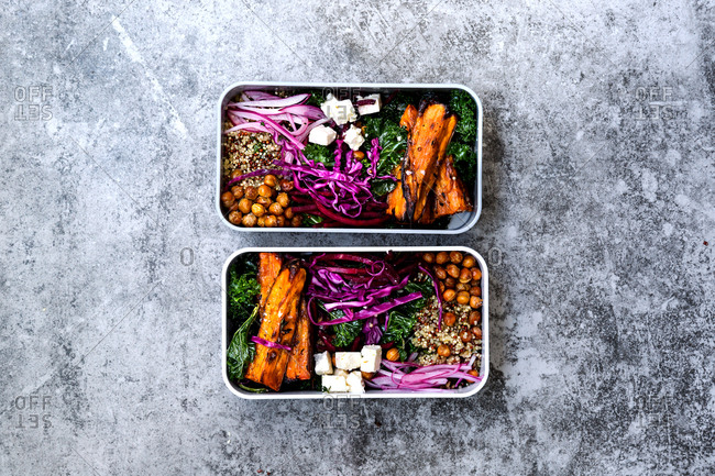 Bento boxes consisting of kale, quinoa, roast sweet potato wedges, red cabbage, beetroot, chickpeas and feta cheese