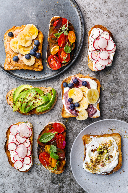 Slices of toast with various savory and sweet toppings