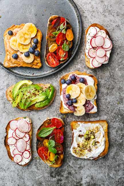 Various savory and sweet toppings on slices of toast