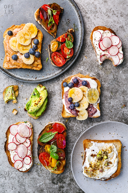 Slices of toast served with various sweet and savory toppings