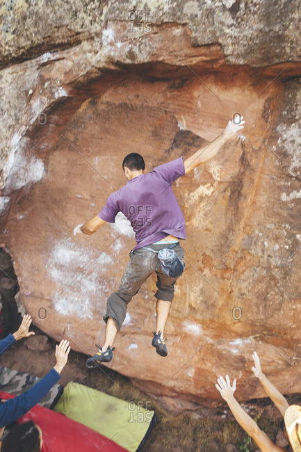 Rock climber falling from a steep overhanging boulder problem