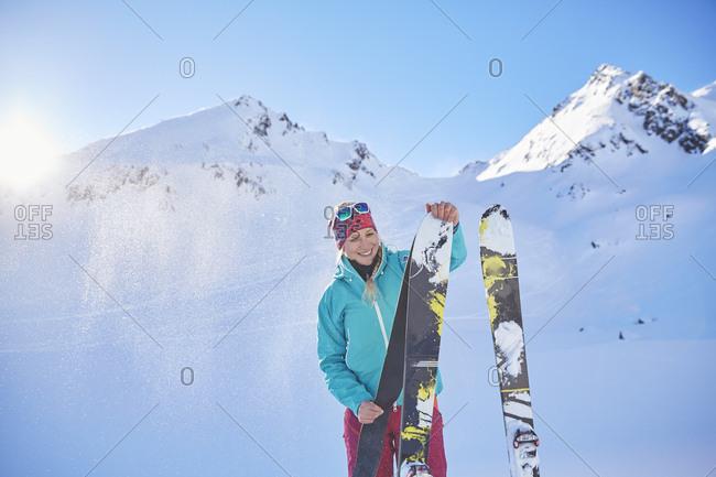 Austria- Tyrol- Kuehtai- freeride skier preparing ski for a ski tour