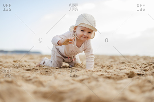 Spain- Lanzarote- baby girl crawling on the beach