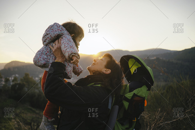 Spain- Barcelona- grandmother with granddaughter during a hike at sunset