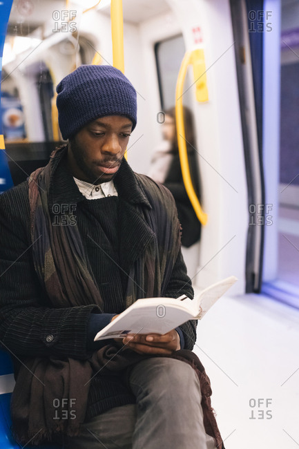 African american man reading a book