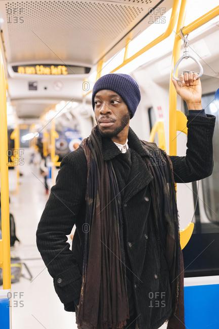 African american man in underground train