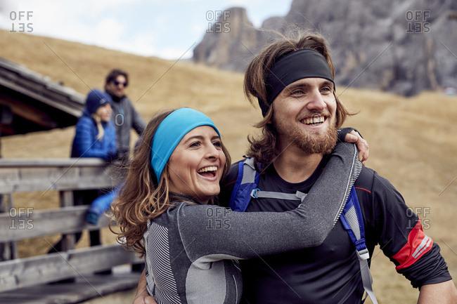 Happy friends having a break at mountain hut