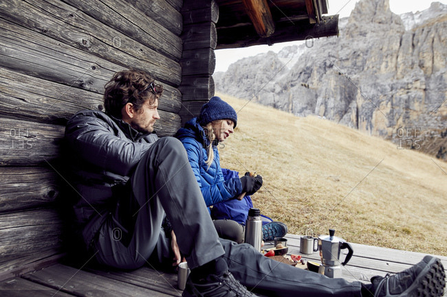Couple having a break at mountain hut