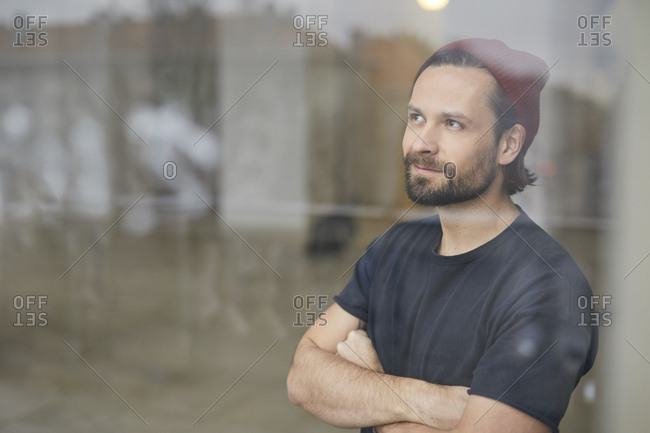 Portrait of an artist in his atelier looking out of window