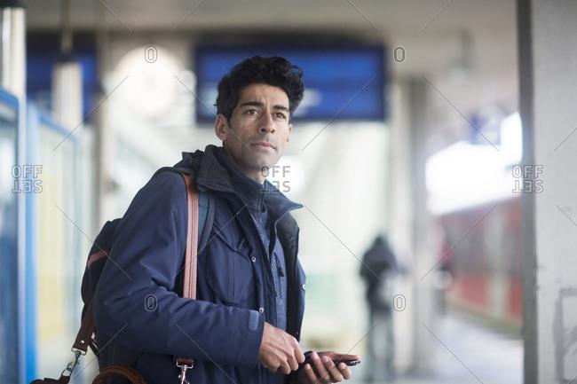 Portrait of man waiting on platform