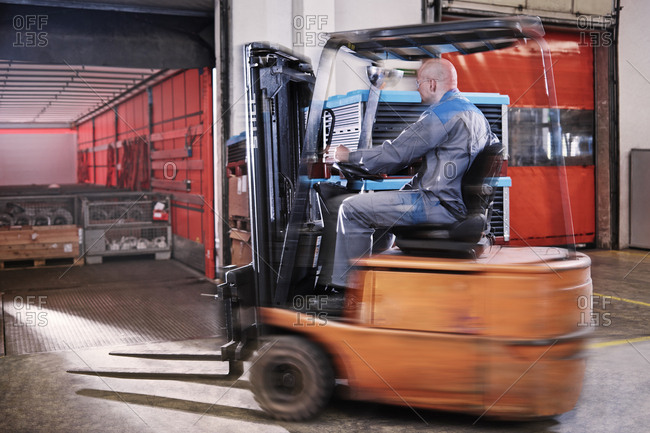 Fork-lift driver loading lorry