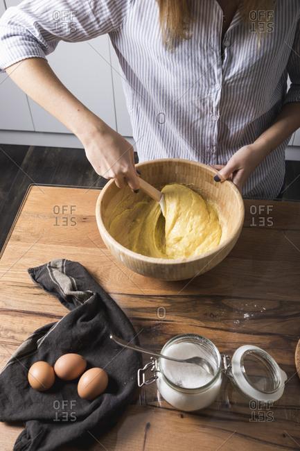 Woman stirring dough