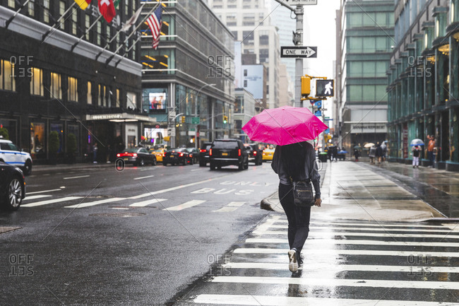 USA- New York- woman in the city on a rainy day