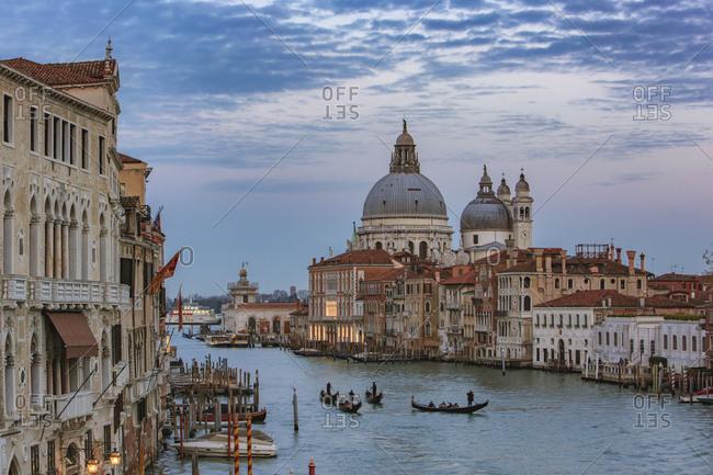 Italy- Veneto- Venice- Gondolas on Canal Grande in front of Basilica Santa Maria della Salute