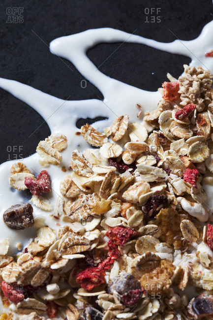Fruit granola with dried fruits on yoghurt splash