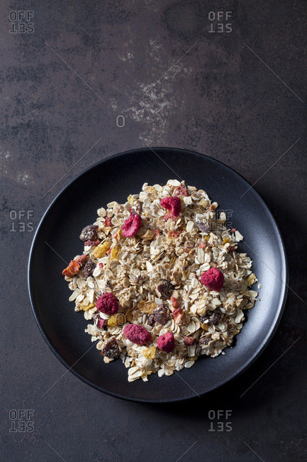 Bowl of fruit granola with dried raspberries- strawberries and cranberries
