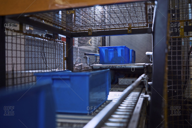 Blue boxes on conveyor belt