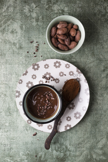 Cup of chocolate pudding with cacao- cacao nibs and cocoa beans
