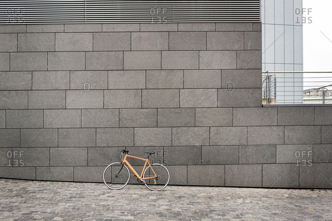 Bicycle at a wall in the city