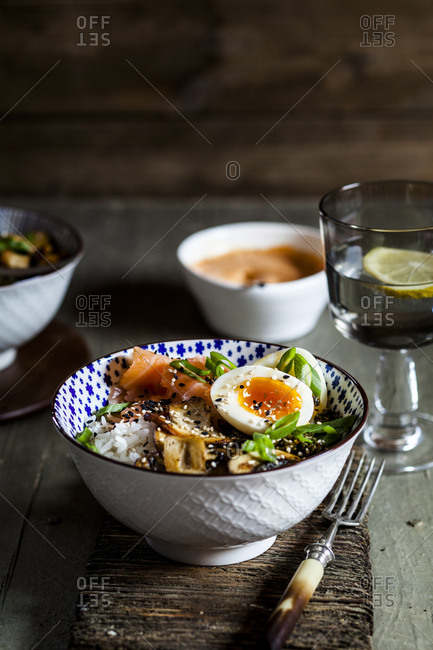 Lunch bowl- cooked egg- rice- smoked salmon- mushroom- green cabbage- sesame