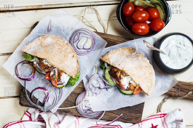 Chicken gyros- chicken- salad- tomato- cucumber- onion- tzatziki- homemade gluten free pita bread